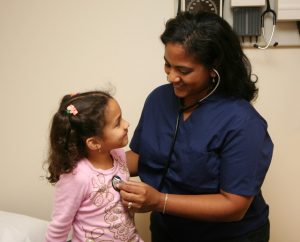Health nurse with a child