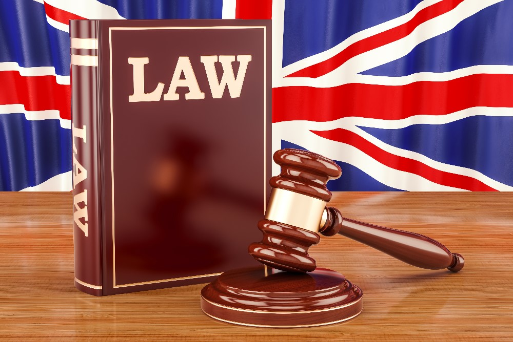 Law book, union jack and judge's gavel