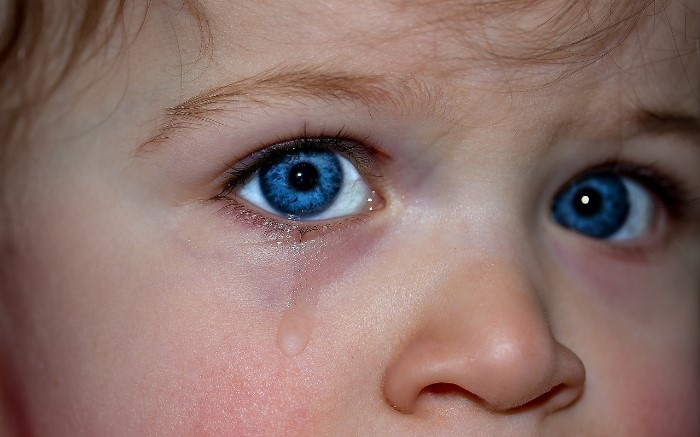 Young child with tears in eyes