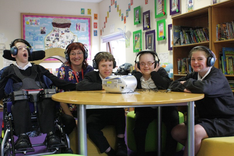 Children and young people with SEND wearing headphones and listening to music