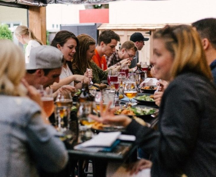 Young people eating and drinking a restaurant
