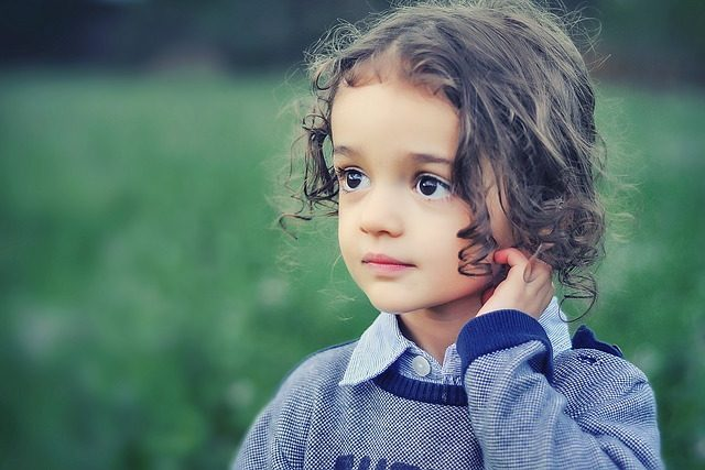 Young girl looking thoughtful